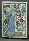 Three Persian Glazed Earthenware Tiles