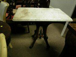 Victorian White Marbletop Table and a Renaissance Revival Gilt and Ebonized Walnut Mirror