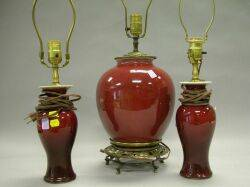 Three Chinese Sang de Boeuf Glazed Porcelain Table Lamp Bases