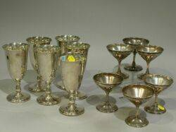 Set of Six Reed  Barton Sterling Silver Water Goblets and a Set of Six Wallace Sterling Silver Champagnes