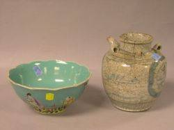 Chinese Enamel Decorated Porcelain Bowl and a Blue and White Decorated Crackle Glazed Stoneware Jar