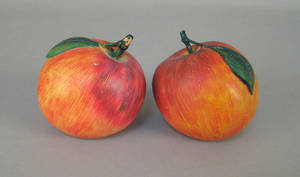 Pair of carved and painted apples ca 1900