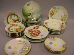 Twentyone Handpainted Floral Decorated Porcelain Plates and a Set of Six Tulip Transfer Decorated Porcelain Plates