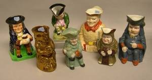 Seven Assorted Glazed and Decorated Ceramic Toby Jugs