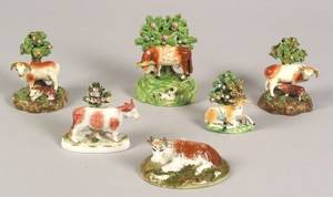 Four Polychrome Staffordshire Pottery Figures and Two Porcelain Figures