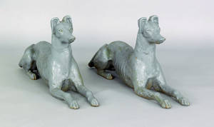 Pair of cast iron recumbent whippets 19th c