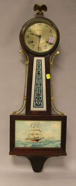 New Haven Clock Co Whitney Federalstyle Mahogany and ReversePainted Glass Banjo Timepiece