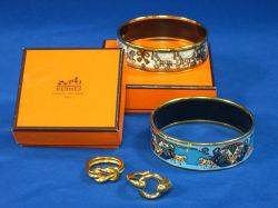 Two Hermes Costume Jewelry Enamel Bangle Bracelets and Two Gold Tone Rings Rings