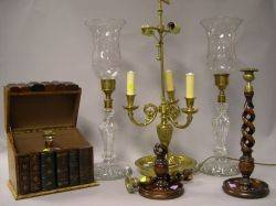 Faux Book Liqueur Box and Ice Bucket a Pair of Elm Barley Twist Candlesticks a Neoclassical Brass Table Lamp and a Pair of Colorless