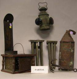 Bed and Footwarmer Two Tin Candlemolds a Pair of Tin Candle Sconces Two Pierced Tin Lanterns an Iron Meat Hook a Wrought Iron Peel