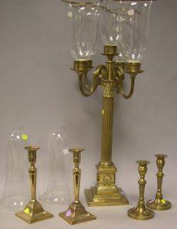 Neoclassical Brass FourArm Candelabra with Glass Shades Two Pairs of Brass Candlesticks and a Pair of Glass Shades