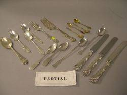 Fiftyfour Pieces of Sterling Silver Flatware Seven Coin Silver and Thirteen Plated Silver Flatware Items