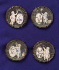 Four Antique Buttons