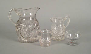 Four colorless blown glass threemold articles 19th c