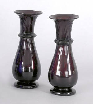 Pair of puceamethyst blown glass footed vases early 19th c