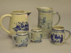 Three Cobalt Decorated Molded Stoneware Mugs and Two Cobalt Decorated Stoneware and Ceramic Pitchers