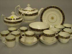 Twentyone Piece English Gilt and Cobalt Decorated Partial Ceramic Tea Service