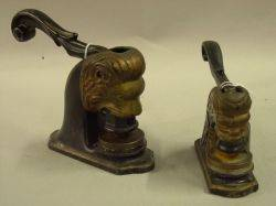 Two Early 20th Century Cast Iron and Bronze Figural Lionhead Seal Embossers