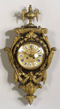 Small Louis XVIstyle Gilt Metal Mounted and Ebonized Wood Cartel Clock