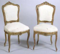 Set of Four French Rococo Revival Giltwood Side Chairs