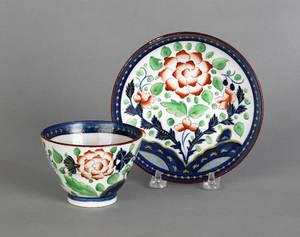Gaudy Dutch primrose cup and saucer 19th c