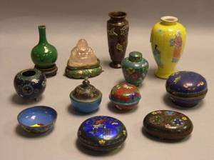 Eight Asian Cloisonne Table Items a Carved Hardstone Buddha Two Asian Ceramic Vases and a Bronze Vase