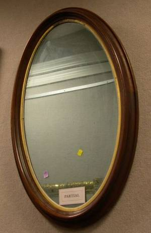 Parcel Gilt and Mahogany Veneer Mirror and a Victorian Oval Walnut Framed Mirror