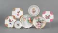 Seven painted porcelain plates
