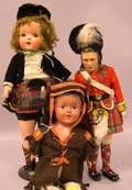 Three Cloth and Composition Dolls
