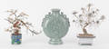 Pair of carved hardstone trees in enameled vases