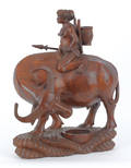 Southeastern Asian carved wooden figure of a water buffalo and rider