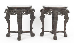 Pair of Chinese carved teakwood end tables with round inset marble tops