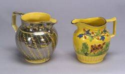Two Yellow Glazed Earthenware Pitchers
