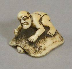 Group of Ivory netsukes including an Ivory Netsuke of a Man on a Tortoise