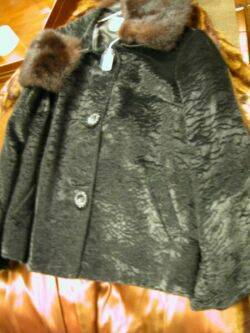 Three Fur Coats and Stole Ostrich Trimmed Mink Stole Fur Trimmed Coat Cape and a Fox Hat