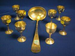Whiting Aesthetic Sterling Silver Ladle and a Set of Eight 990 Silver Egg Cups