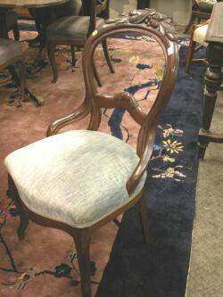 Set of Four Victorian Rococo Revival Upholstered Carved Walnut Side Chairs