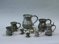 Set of Seven English Pewter Measures and Two Other Measures