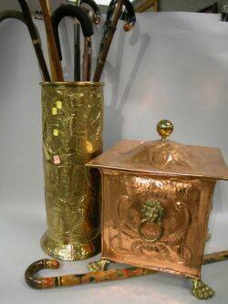 Brass Repousse Umbrella Stand with Collection of Canes Hammered Copper Hearth Box Pair of Brass Andirons Three Tools and Two Rests