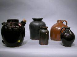 Two Brown Glazed Stoneware Jugs and a Brown Glazed Redware Crock