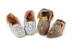 Two pairs of Native American beaded hide moccasins
