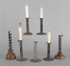 Five hogscraper candlesticks together with two twist ejector candlesticks