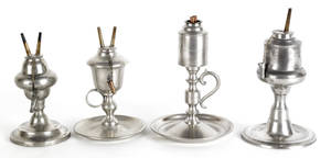 Four American pewter oil lamps mid 19th c