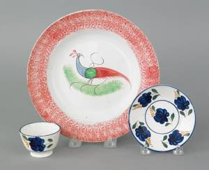 Red spatter plate with peafowl