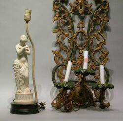 Painted Metal ThreeLight Wall Sconce a Parian Figural Table Lamp and a Blond Wood Flattop Desk