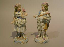 Pair of German Bisque Figures of a Boy and Girl