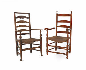 Two rush seat ladderback armchairs