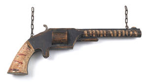 Painted pine gun trade sign late 19th c