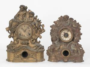 Two iron face mantle clocks