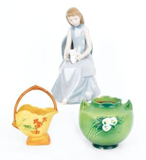 Lladro figure of a girl with a cat